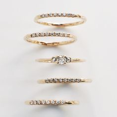 Our Trinity Ring nestled between layers of Pavé Arc Rings #diamond #rosecut #14k #gold #ringstack #valejewelry