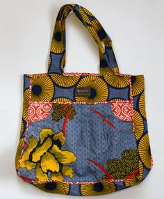 Roomy and bright, this go-to bag is inspired by the lush landscape of Rwanda, the country where it is carefully stitched.      Our Noonday customers put a group of women through sewing school in Rwanda and this is part of their first collection. Thanks to their new skills and work opportunity, these women are able to create a more stabilized income for themselves and their families.      19
