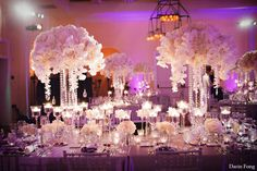 love the varying heights of the tall and low centerpieces, and the glow from the candles is perfect!