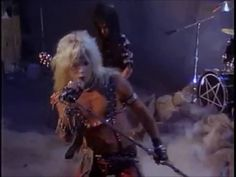"Motley Crue's ""Looks That Kill"". I love this song but cannot stand the ""man doll"" exhibitionism. Excerpt: Now she's a cool, cool black - Moves like a cat - If you don't get her game -You might not make it back."