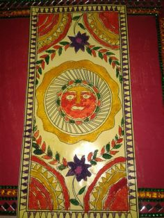 A Madhubani template decorated by colored sand