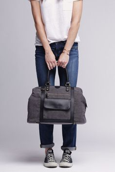 Our Jude Bag is a larger bag, designed for both men and women that will accommodate quite a bit of gear. The grey canvas and black trim giv...