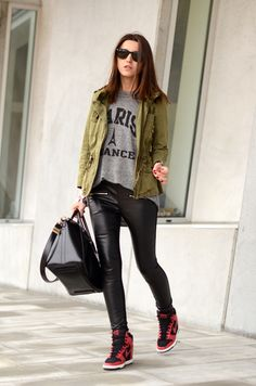 red wedge sneakers, pleather leggings, worn and grey tee, and army parka