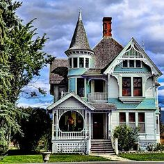 victorian houses are my favorites. i would make the roof a darker black and the house yellow instead of blue and the molding a crisper white :)