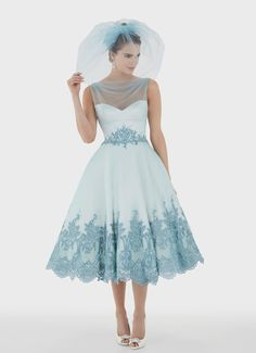 Fantastic shape and detailing! Though I don't think I'm bold enough for the blue lace... good thing it comes in ivory, too.
