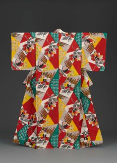 Short-sleeved kimono with all over geometic design of green, red, gold and gray trianges and stripes with bouquets of flowers; lined with red cotton plain weave and pink sik crepe