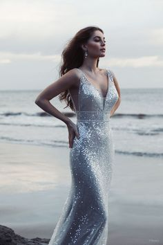 This Ariel-inspired gown is playful, yet elegant. A subtle flared train is reminiscent of a mermaid's silhouette, while sparkling sequins mimic the play of light across the moonlit sea. Allure Bridals, Wedding Dress Sizes, Designer Wedding Dresses, Bridal Gowns, Wedding Gowns, Disney Collection, Spring Collection, Princess Bridal, Essense Of Australia