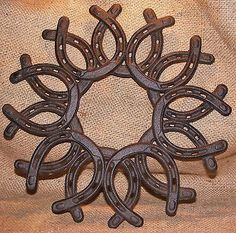 Cast Iron Horse Shoe Wreath - This listing is for ONE Cast Iron Horse Shoe Wreath Great for a country or western-themed home or garden project! - Very sturdy cast iron with rusty brown finish and nice More