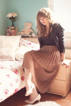 Pleated skirt with leather jacket! honor roll with a touch of bad