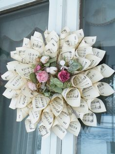 Hymnal paper cone wreath. Gonna try this for a Christmas gift for someone! Hope my floral arrangement turns out as nice.