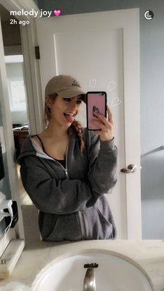 This is so darn cute... *hearts around the phone* with a big jacket tongue out and the cap with a braid