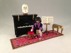 Playmobil Victorian Pianist with working Piano - vintage early 1990's - set complete #5551.  Sold for $64.99 + shipping on Ebay.
