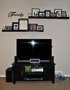 Shelves above tv...don't necessarily like the decor on and around the shelves, but the layout is good for the area.