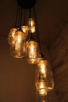 """From Tugboat Steampunk by Wilson and Wood our """"Lydd"""" 8 drop, mason jar pendant lamp with complete with squirrel cage bulbs. Featuring a large ceiling rose and beautiful braided cables. All fully customisable to suit your needs...just ask !"""