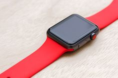 Apple Watch Sport Space Grey Case with (Product) Red Sport Band.