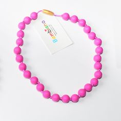 Bambiano Nicole Jr Necklace in Hot Pink. Bambiano Jr Necklaces are made of 100% Food grade silicone. BPA free, Lead free and nontoxic. Fashionable for trendy girls 3 years and above. Necklaces are colourful, washable and soft against the skin. Shop at www.bambiano.com