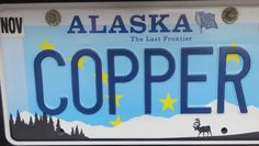 Alaska license plate refers to Copper River, a great place for fishing.