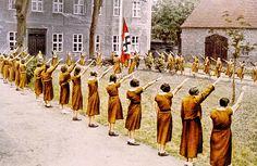 Nazi Germany, Junge Deutsche Madel, giving the Nazi salute, c. 1933.
