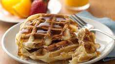 Cheese and Bacon-Filled Waffles: Crescents filled with salty cheese and bacon topped with sweet maple syrup make a great breakfast waffle.