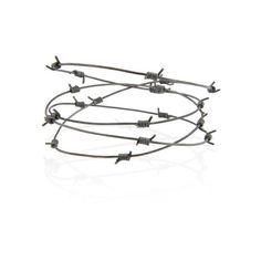 Tom Binns Barbed Wire Bracelet (£235) ❤ liked on Polyvore featuring jewelry, bracelets, black, tom binns, gunmetal jewelry, barb wire jewelry, tom binns jewelry and barbed wire jewelry
