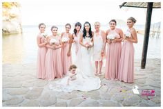 The beautiful bride with her best bridesmaids by her side!