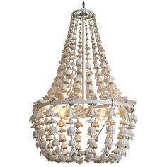 The Flower Frenzy Chandelier features an abundance of cast resin flowers cascading from the antique white frame. All of springs flowers are preserved and forever in bloom in this bold white chandelier.