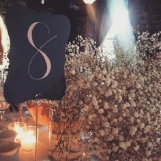 Hand written table numbers for wedding. Blue and blush pink