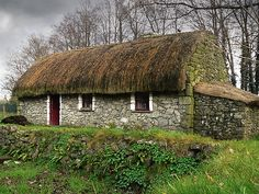 Old tatched Irish country famine cottage