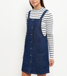 "Wear this denim pinafore dress over a stripe long sleeve top and plimsolls, for casual day wear.- Square neckline- Button front fastening- Double pocket front- Casual fit that is true to size- Mini length- Soft cotton fabric- Model is 5'8""/176cm and wears UK 10/EU 38/US 6"