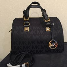 Sale New Michael Kors Satchel New with tags 100% authentic Michael Kors monogrammed black satchel. Comes with crossbody strap Michael Kors Bags