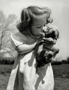 Bernard Hoffman - Christina Goldsmith kissing a Weimaraner puppy  USA, 1950.