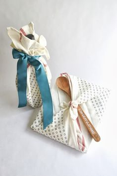 cookbook and wooden spoon or spatula set or a cute whisk all tied up in a tea towel! I think the other one is EVOO practical bridal shower favor ideas
