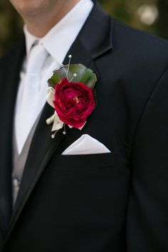 Groom in black suit with crimson garden rose boutonniere {Meg Ruth Photo}