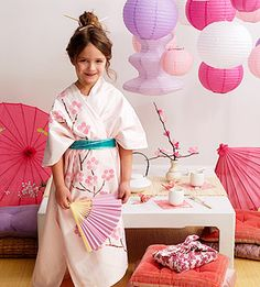 """Japanese Kimono Costume    Upcycle a sheet into a lovely kimono for the birthday girl to wear on her special day. Use a cork and sponge brush to create the floral pattern.    What you'll need:  Twin flat sheet, scissors, pink and brown acrylic paint, wine cork, 1"""" sponge brush, ribbon"""