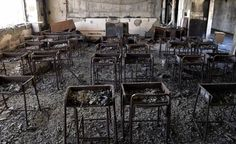 Charred desks and chairs still stand in a classroom in Kadowaki Elementary School, which was gutted by fire after the March 11 tsunami, in Ishinomaki, Miyagi Prefecture.