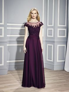 Val Stefani Style MB7446 A sheer bateau neck is complimented with corded lace appliques along with cap sleeves. The pleated band cinches the drop waist of this sheath gown.
