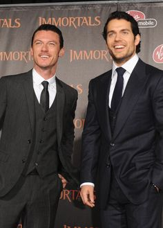 Luke Evans, Henry Cavill Sweet Jesus just let me stand between them once.... i would die happy.
