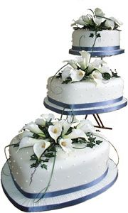 heart shaped wedding cakes | ... very unique three tiered heart shaped wedding cake with lily flowers