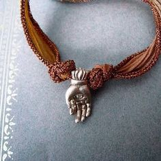 love the mudra and the beaded edge ribbon.