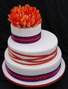 Purple & Orange cake. Repinning because of the shape and those are my wedding colors... but not those shades.