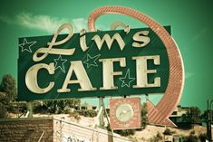 Lim's Cafe neon sign with temperature gauge + best execution of an arrow on a vintage sign!