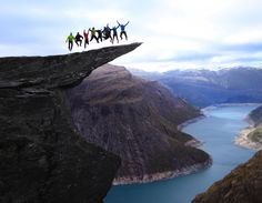 Jumping on the Trolltunga rock in Norway.