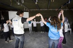 Orlando joins children in a dance at an adolescent-friendly centre in the Za'atari refugee camp.