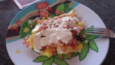 Rancho Carne eggs. Buffalo infused ranch over natural salsa on eggs. (It works best with salsa like Chipotle mild)