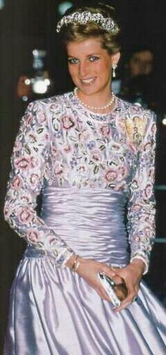 Princess Diana wore this purple full length dress by Catherine Walker for a visit to meet the Crown Prince, Sheikh Saad Al Abdullah