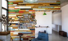 Brahma-Architects' LAHO House in Israel combines with stucco with a colorful recycled wooden wall.