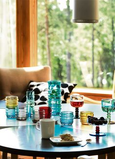 """Sipping summer drinks from these mouth-blown soda-lime glasses stained a stunning lemon yellow = heaven. Marimekko """"Socks Rolled Down"""" Yellow Tumbler (Set of - we love them at Cloudberry Living they are fun, cool and beautiful to drink from."""