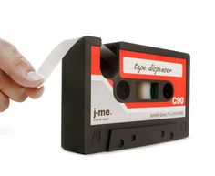It's official... cassette tapes are back! This easy to use tape dispenser is in the shape of a cassette tape. We'd like to see them try to pull this off with a CD!   Mix things up at your desk and pay homage to the beloved cassette tape of the 70s and 80s with this heavy duty, lighthearted rubber desk accessory. $18.95