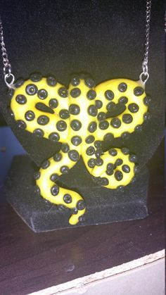 Batman themed polymer clay bow. Love this and perfect for a geek like me.  Check out this item in my Etsy shop https://www.etsy.com/listing/244451528/batman-themed-polymer-clay-octopus