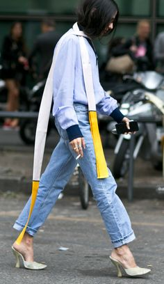 See All the Milan Fashion Week Street Style Fall 2015 - cuffed baggy denim + long, skinny scarf with a pop of yellow